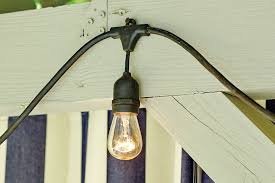 hanging outdoor string lights how to hang string lights rounding lights and backyard