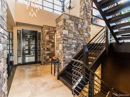 modern entryway with metal stair railing by ken caiani zillow