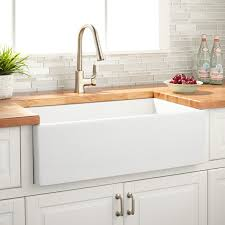 white kitchen cabinets with farm sink 33 grigham reversible fireclay farmhouse sink white