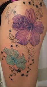 2 flower butterflies on thigh tattoomagz
