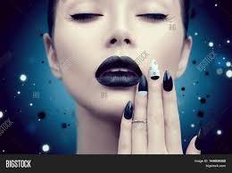 high fashion model portrait with trendy gothic black make up