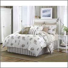 white shell bedding set on the bed completed by cushions and