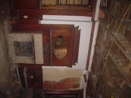 antique monumental art deco aztec style mahogany double door and