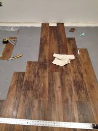 Is Laminate Flooring Good For Basements Installing Peel And Stick Laminate Floors In A Basement Remodel By