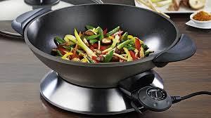 comment cuisiner au wok choisir un wok les bonnes questions