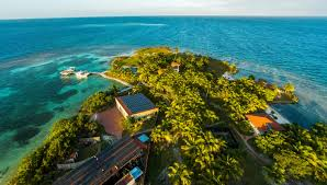 buy a private island off the coast of belize robb report australia