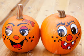 painted pumpkins on a wooden tabel stock photo picture and