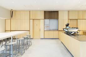 schemata architects creates minimal interior for blue bottle