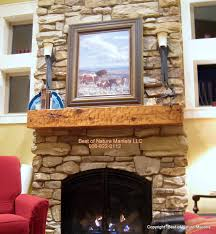 interior stone fireplace mantels with sconaces and red armchiar