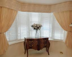 bay window stone pelmet and curtains window treatments