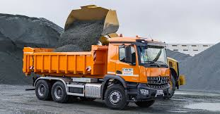 siege social mercedes on the construction site with an arocs 2643 dumper truck from le