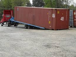 how do you move a ground level shipping container for storage