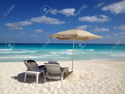Chairs On A Beach Two Beach Chairs On A White Sand Beach With Umbrella And Turquoise