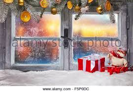 atmospheric christmas window sill with decoration and blur tree