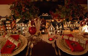 christmas table setting tablescape with dept 56 lit houses and