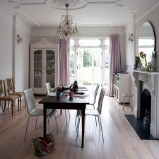 dining table in front of fireplace lavender curtains eclectic dining room house to home