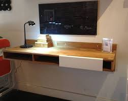 lax wall mounted desk takes up less space and could work as a