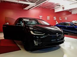 tesla tesla offers 700 000 u0027bonus u0027 incentive to its global sales and