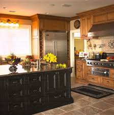 distressed wood cabinets kitchen rustic with accent tiles black