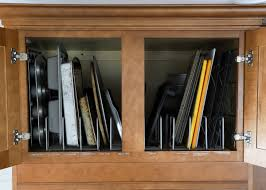 how to trim cabinet above refrigerator how to organize cabinets above the refrigerator the homes