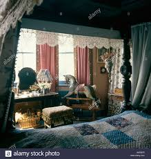 bedroom with view from four poster bed of rocking horse beside