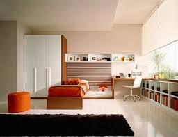 fresh teen room decor with orange bed black rug wooden desk and