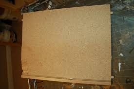 peeling off particle board covering fabulously finished
