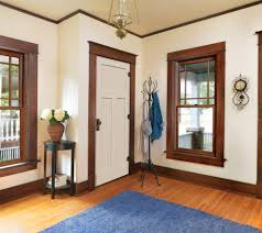 stained trim painted door entry traditional with arched doorway