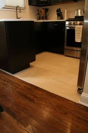 Kitchen Hardwood Floors by Light Tile With A Seamless Transition To Dark Wood Floor Perfect