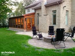 screen porch with fireplace and patio with fire pit u2013 archadeck of