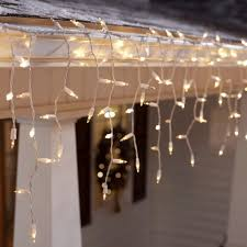 Icicle Lights Hanging From A Gutter Best Way To Hang Christmas