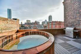 marlborough street townhouse with tub on the roof lists for