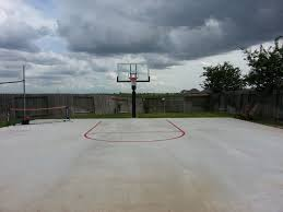 the key on this basketball court is striped in red creating great