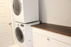 ikea kitchen cabinets laundry room ikea desk top turned laundry room cabinet top book