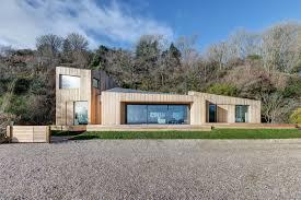 ar design studio replaces landslide damaged holiday home with