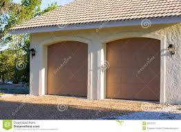 two car garage doors examples ideas pictures megarct com just 954 916c3a of exterior of modern two car garage with doors closed in florida wallpaper