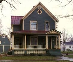 dark paint exterior color with pale yellow trim line for