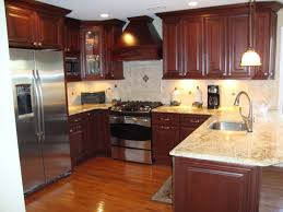 marble countertops kitchen with cherry cabinets lighting flooring