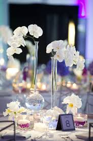 orchid centerpieces modern purple blue white wedding at contemporary chicago venue