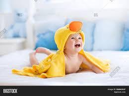 happy laughing baby wearing yellow image u0026 photo bigstock