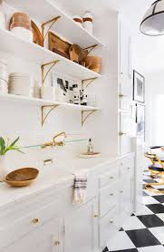 brady kitchen reveal emily henderson when first moved into the apartment there was one single shelf this wall above sink and not only pretty shallow but little bit