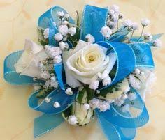 turquoise corsage wrist corsage of lavender spray roses accented with silver