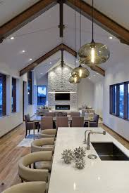 kitchen island pendant light fixtures kitchen island pendant lights bring warmth to aspen mountain home
