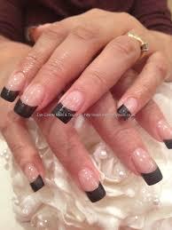matt black tips with shiny detail nail art on acrylic nails