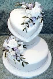 heart shaped wedding cakes two tier heart shaped wedding cake unique wedding ideas