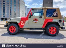 red customized jeep wranglers custom painted jurassic park jeep jurassic park logo 4x4 vehicle