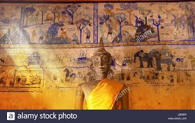 buddha statue and ancient paint wall thai style inside of church