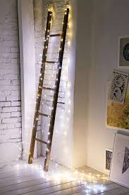 ladder christmas tree make a decorative ladder christmas ready by encasing it in lights