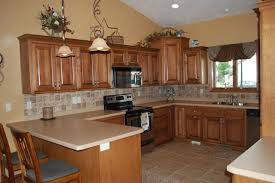 tile floors distressed turquoise kitchen cabinets electric range