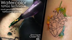 watercolor tattoo technique small geometric heart tattooing